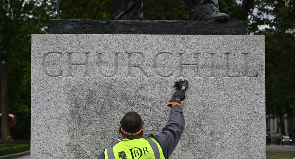 The statue of former British prime minister Winston Churchill is cleaned in Parliament Square, central London on June 8, 2020, after being defaced, with the words (Churchill) was a racist written on it's base by protesters at a demonstration on June 7, 2020, organised to show solidarity with the Black Lives Matter movement.