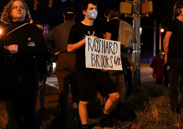 Protesters rally against racial inequality and the police shooting death of Rayshard Brooks, in Atlanta, Georgia, U.S. June 13, 2020.