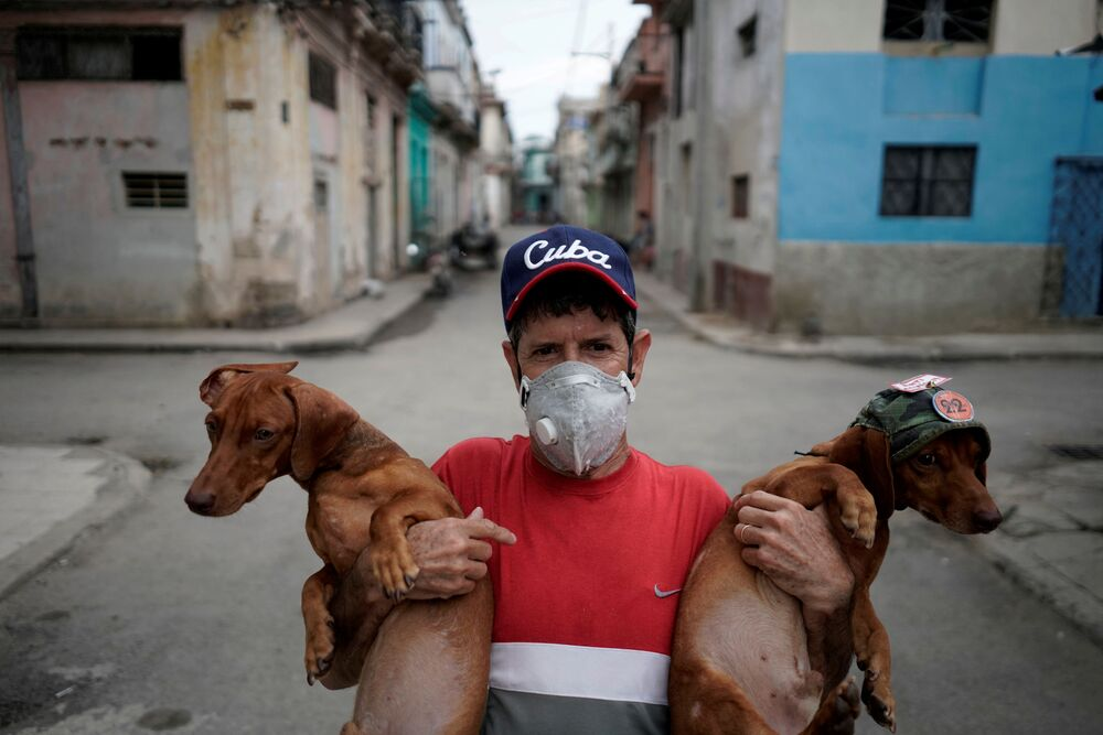 Roberto Gonzalez, who produces mini shows for tourists with his two Dachshunds, poses for a photo in front of his home amid concerns about the spread of the coronavirus disease (COVID-19), in downtown Havana, Cuba, 18 May 2020.