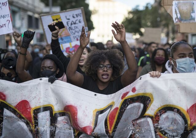 Hawa Traore chants during a march against police brutality and racism in Marseille, France, Saturday, June 13, 2020, organized by supporters of her brother Adama Traore, who died in police custody in 2016