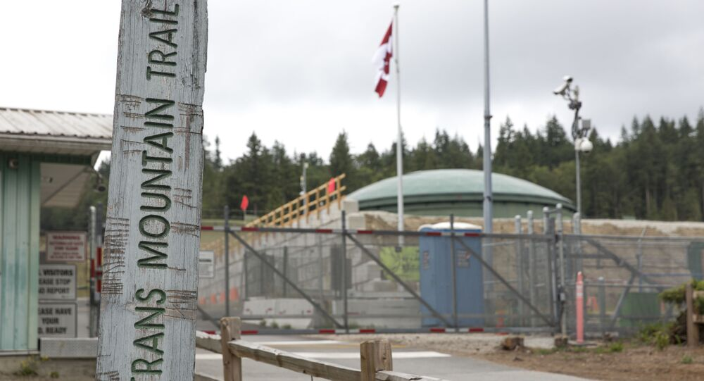 A marker for the Trans Mountain Trail is pictured outside the Kinder Morgan Burnaby Terminal and Tank Farm in Burnaby, British Columbia on June 20, 2019.