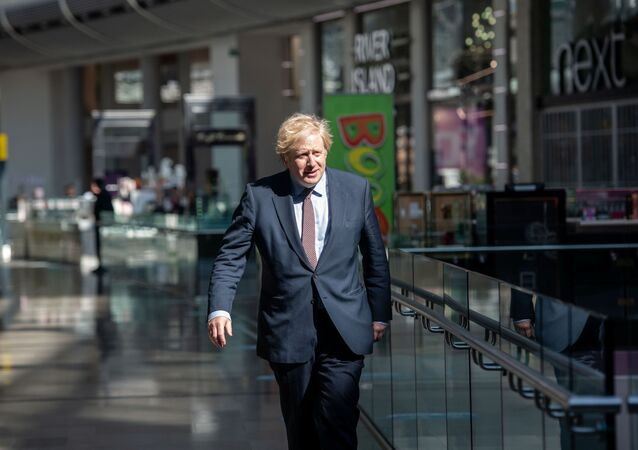 Prime Minister Boris Johnson visits the M&S clothing department and other retail outlets in Westfield Stratford to see the COVID-19 measure taken before reopening tomorrow, in London, Britain June 14, 2020.