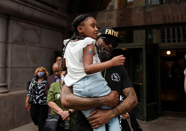 Former NBA player Stephen Jackson carries George Floyd's 6-year-old daughter, Gianna, after speaking about his death in Minneapolis police custody, at the Minneapolis City Hall, in Minneapolis, Minnesota, U.S., June 2, 2020