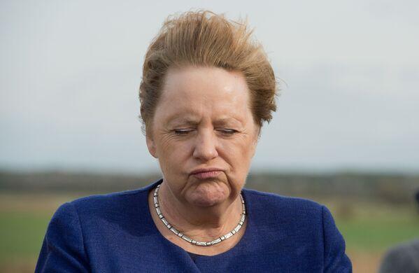 Канцлер Германии Ангела Меркель на сильном ветру, 2019 год - Sputnik International