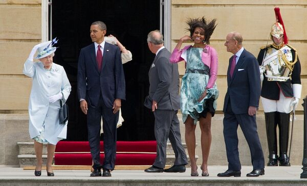 Britain's Queen Elizabeth II (L), former US President Barack Obama (2nd L), former US First Lady Michelle Obama (3rd R) and Prince Philip, the Duke of Edinburgh (2nd R) watch a Guard of Honour at Buckingham Palace, in central London, on May 24, 2011 - Sputnik International