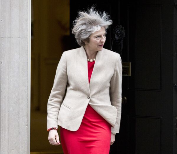 The wind catches the hair of former British Prime Minister Theresa May as she comes out of Downing Street to greet New Zealand Prime Minister Bill English in London on January 13, 2017 - Sputnik International