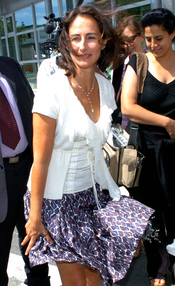 Former presidential candidate Segolene Royal holds her skirt as the wind blows during her visit of the French engineering group Alstom plant in Aytre, near La Rochelle, southwestern France, Thursday, Aug. 24, 2006 - Sputnik International