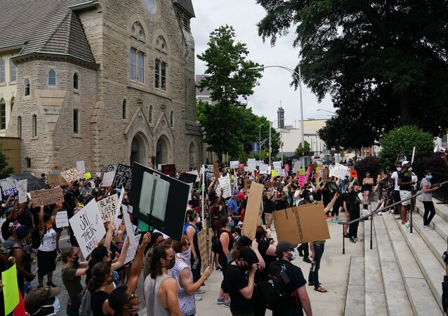 People gather outside the Georgia State Capitol during a protest against police brutality on June 6, 2020 in Atlanta, Georgia.