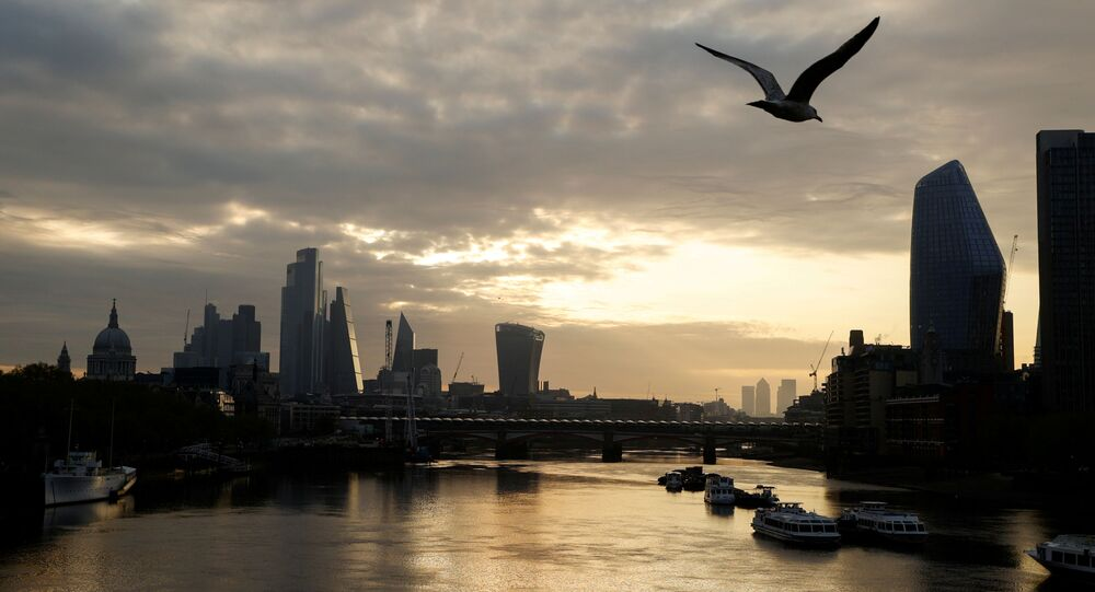 FILE PHOTO: The city of London financial district and the river Thames are seen in early morning, as the spread of coronavirus disease (COVID-19) continues in London, Britain, April 19 2020