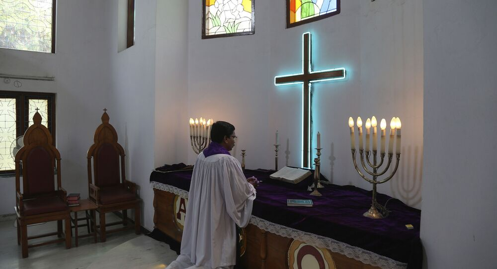 Indian protestant priest offers special prayers on Easter at Lutheran Church in Hyderabad, India, Sunday, April 12, 2020