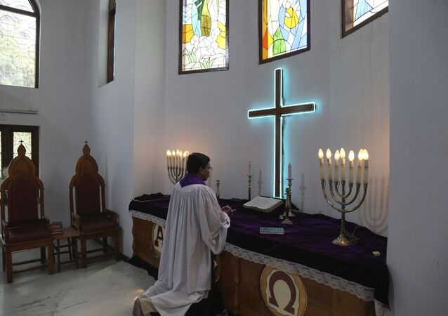 Indian protestant minister offers special prayers on Easter at Lutheran Church in Hyderabad, India, 12 April  2020