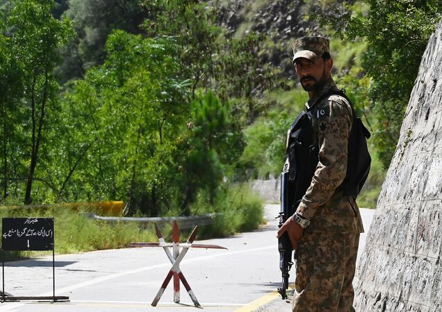 A Pakistani soldier patrols near the Line of Control (LoC), the de facto border between Pakistan and India, in the Chakothi sector of the Pakistan-administered portion of Kashmir on 29 August 2019.