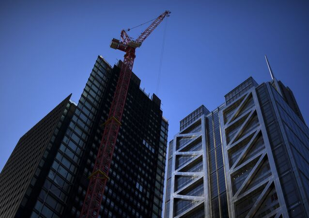 Skyscrapers in the financial district of The City, in London, Tuesday, May 12, 2020. Britain's Prime Minister Boris Johnson announced Sunday that people could return to work if they could not work from home