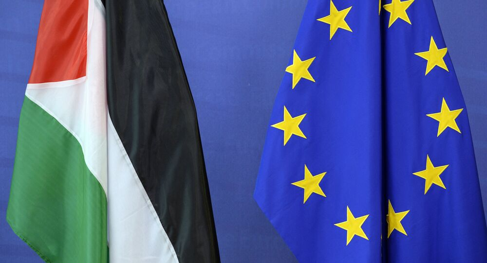 The Palestinian flag (L) is seen next to the European Union flag at the European Union Commission headquarters in Brussels on June 22, 2016