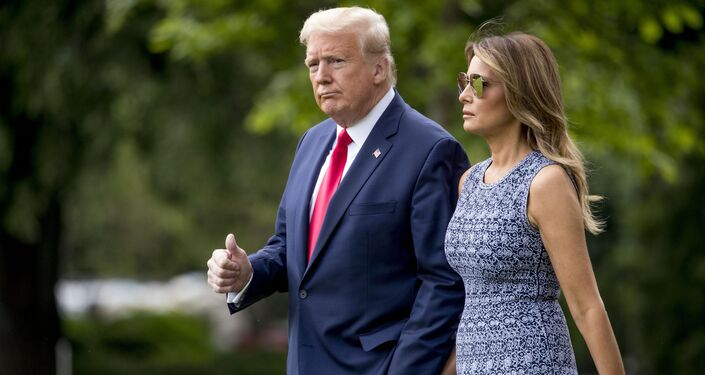 President Donald Trump and first lady Melania Trump walk across the South Lawn of the White House in Washington, Wednesday, May 27, 2020