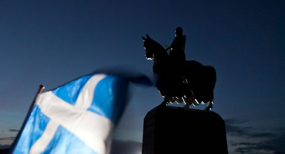 A Scottish Saltire flag blows in the wind near the statue of Scottish King Robert the Bruce, at Bannockburn, Scotland, Thursday, Jan. 12, 2012