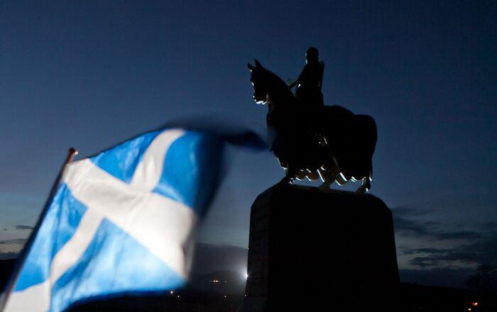 A Scottish Saltire flag blows in the wind near the statue of Scottish King Robert the Bruce, at Bannockburn, Scotland, Thursday, Jan. 12, 2012