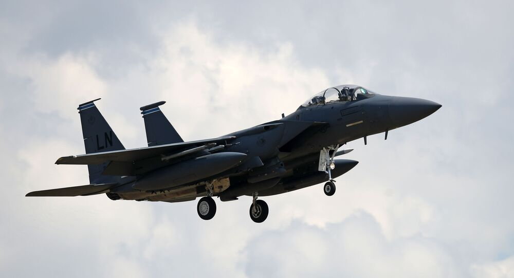 A US Air Force (USAF) F-15E Eagle fighter jet, is pictured as it prepares to land at RAF (Royal Air Force) Lakenheath, east of England, on June 15, 2020.