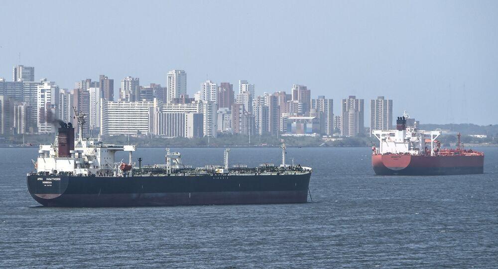 Oil tankers sail the Maracaibo Lake in Maracaibo, Venezuela on March 15 , 2019.