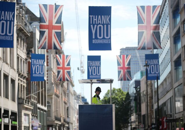 A police officer looks at shoppers at Oxford Street, amid the spread of the coronavirus disease (COVID-19) in London, Britain June 15, 2020.