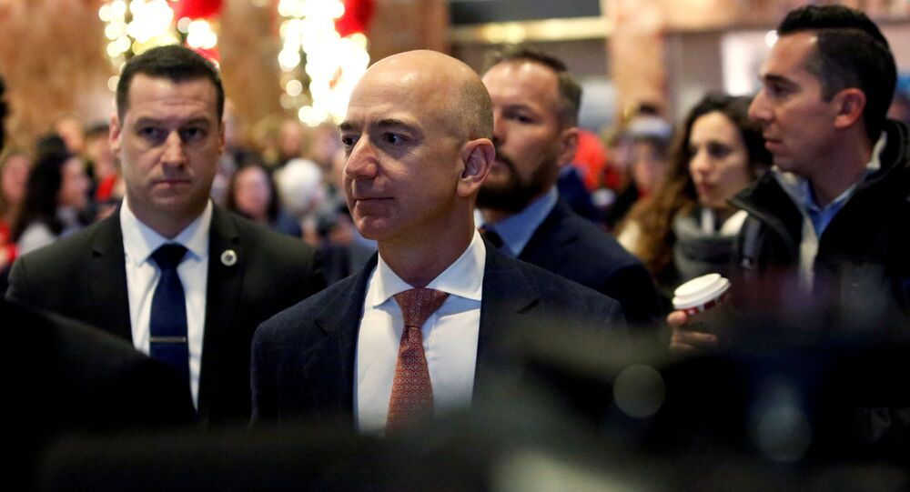 Jeff Bezos, founder, chairman, and chief executive officer of Amazon.com enters Trump Tower ahead of a meeting of technology leaders with President-elect Donald Trump in Manhattan, New York City, U.S., December 14, 2016.