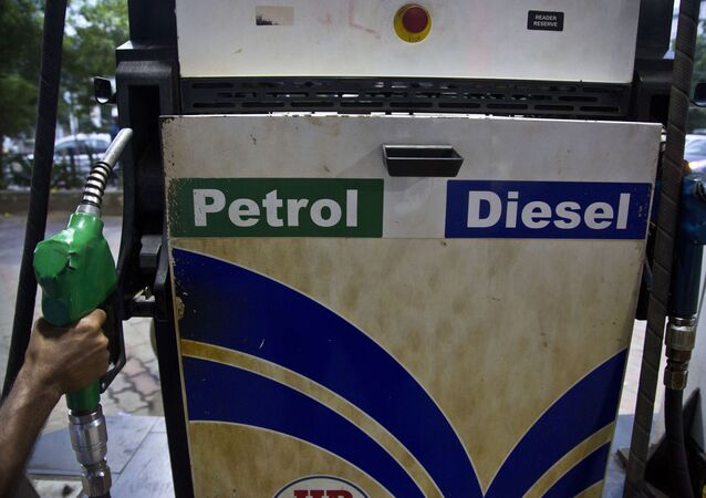 A man prepares to fill fuel in a vehicle at a petrol pump in Gauhati, India, Sunday, Sept. 22, 2019. Fuel prices have increased in the last six days following attacks on key oil facilities in Saudi Arabia.