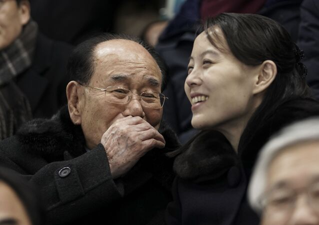 Kim Yo Jong, sister of North Korean leader Kim Jong Un, right, and North Korea's nominal head of state Kim Yong Nam, talk as they for the start of the preliminary round of the women's hockey game between Switzerland and the combined Koreas at the 2018 Winter Olympics in Gangneung, South Korea, Saturday, Feb. 10, 2018.