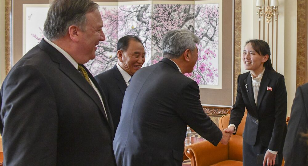 Secretary of State Michael R. Pompeo receives photos from his meeting with Chairman Kim Jong-un from Chairman Kim's sister, Kim Yo-jong, in Pyongyang, Democratic People's Republic of Korea on October 7, 2018