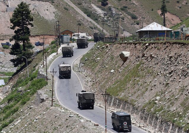 An Indian army convoy moves along Srinagar-Leh national highway, at Gagangeer, in east Kashmir's Ganderbal district, June 15, 2020