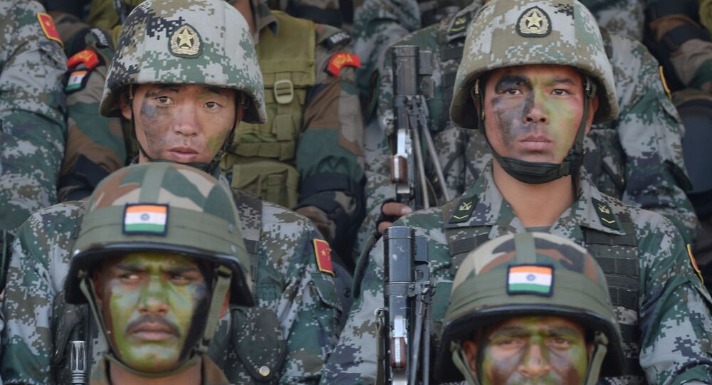 Soldiers from the Indian Army and People's Liberation Army (PLA) sit together after participating in an anti-terror drill during the Sixth India-China Joint Training exercise Hand in Hand 2016 at HQ 330 Infantry Brigade, in Aundh in Pune district, some 145km southeast of Mumbai, on November 25, 2016