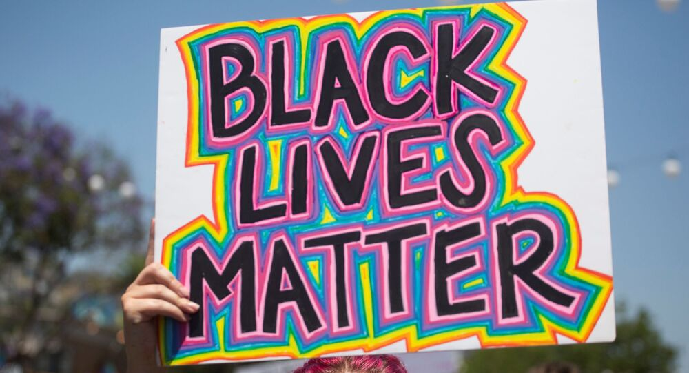 A participant holding a sign reading Black Lives Matter takes part in an All Black Lives Matter march, organized by Black LGBTQ+ leaders, in the aftermath of the death in Minneapolis police custody of George Floyd, in Hollywood, Los Angeles, California, U.S., June 14, 2020