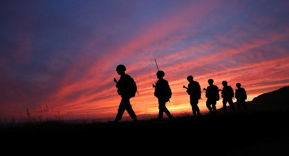 Members of South Korean marine corps patrol during sunset in Yeonpyeong island near the northern limited line, South Korea, June 16, 2020.