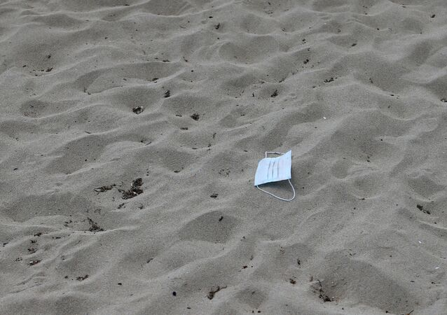 A protective face mask lies on the sand at Playa de Palma beach ahead of Spain's official reopening of the borders June 21 following the coronavirus disease (COVID-19) outbreak, in Palma de Mallorca, Spain June 16, 2020.