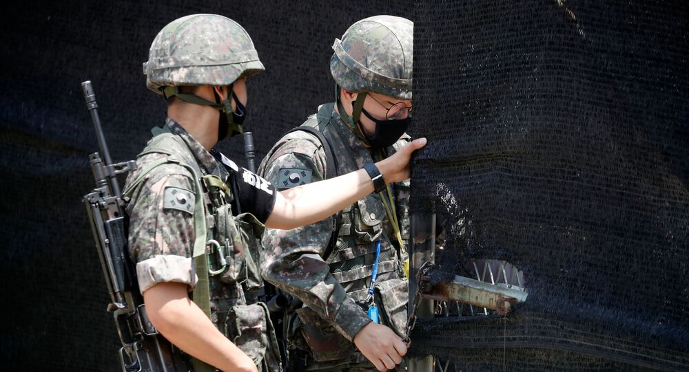 South Korean soldiers check an entrance of their guard post near the demilitarized zone separating the two Koreas in Paju, South Korea, June 16, 2020