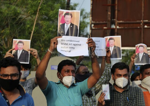 Indians holds photographs of Chinese president Xi Jinping during a protest against China in Ahmedabad, India, Tuesday, June 16, 2020.