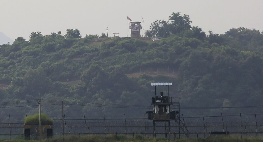 Military guard posts of North Korea, rear, and South Korea, foreground, are seen in Paju, at the border with North Korea, South Korea, Tuesday, June 16, 2020