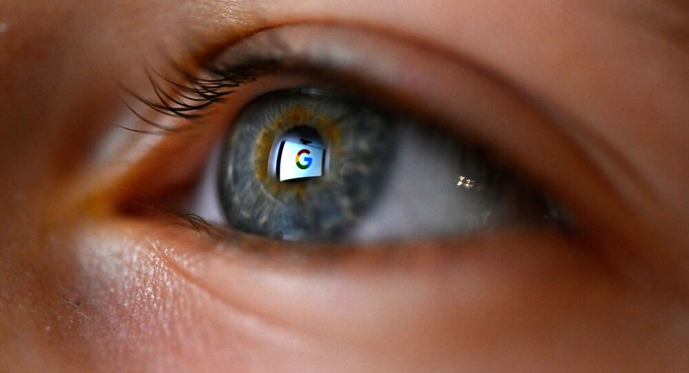This illustration picture, taken on January 12, 2020 shows Google logo reflected on a eye in Rennes, western France
