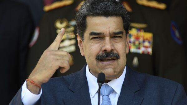 Venezuelan President Nicolas Maduro speaks at a press conference at the Miraflores Presidential Palace in Caracas, Venezuela, Thursday, March 12, 2020 - Sputnik International