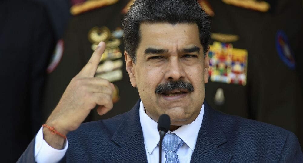 Venezuelan President Nicolas Maduro speaks at a press conference at the Miraflores Presidential Palace in Caracas, Venezuela, Thursday, March 12, 2020