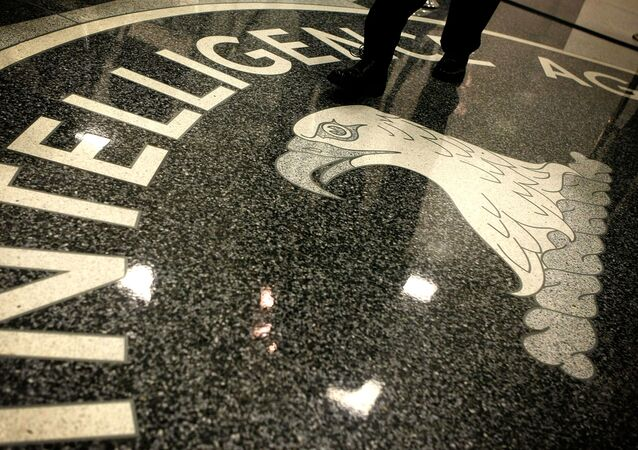 A man walks across the seal of the Central Intelligence Agency at the lobby of the Original Headquarters Building at the CIA headquarters February 19, 2009 in McLean, Virginia
