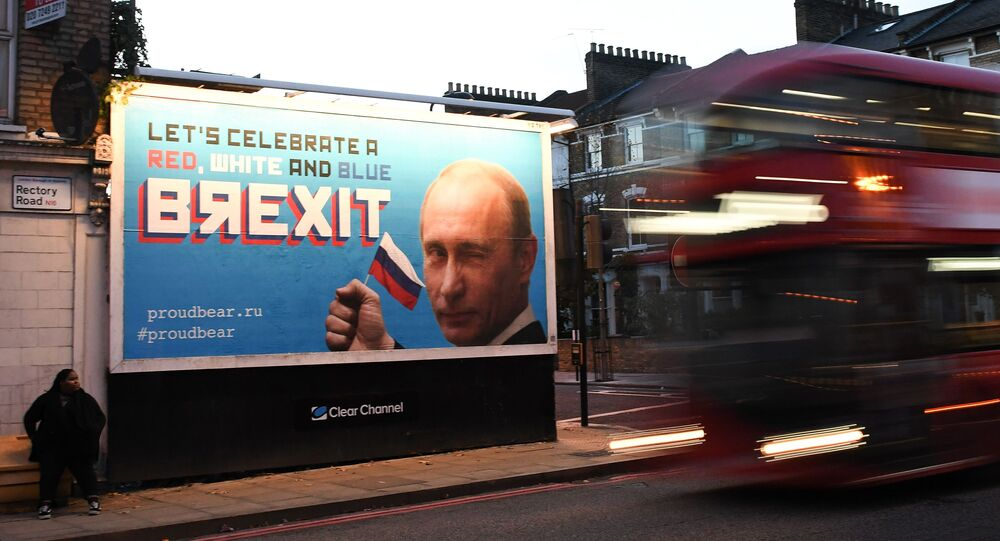 A Brexit-themed billboard depicting Russian President Vladimir Putin that reads Lets celebrate a red, white and blue Brexit is seen in north London on November 8, 2018
