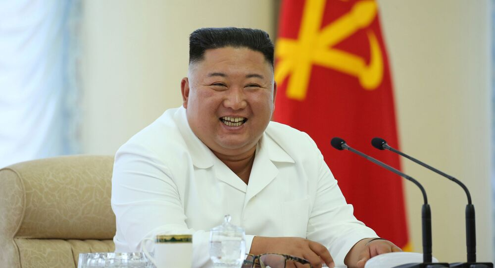 North Korean leader Kim Jong Un takes part in the 13th Political Bureau meeting of the 7th Central Committee of the Workers' Party of Korea (WPK) in this image released June 7, 2020 by North Korea's Korean Central News Agency (KCNA)