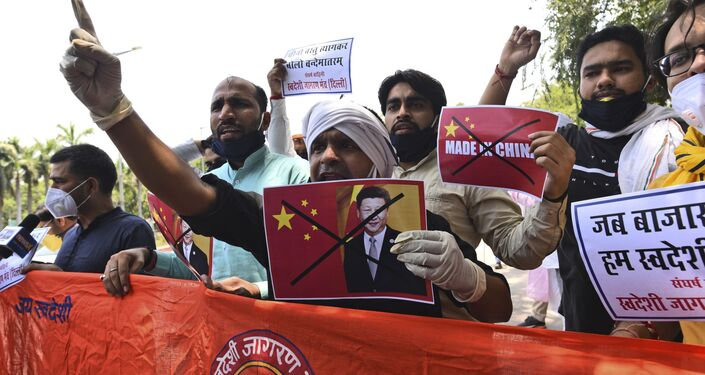 Activists of Swadeshi Jagran Manch shout slogans during a protest near the Chinese embassy in New Delhi, India, Wednesday, June 17, 2020