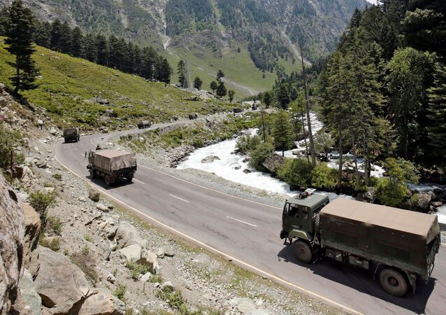 Indian army trucks move along a highway leading to Ladakh, at Gagangeer in Kashmir's Ganderbal district, 17 June 2020