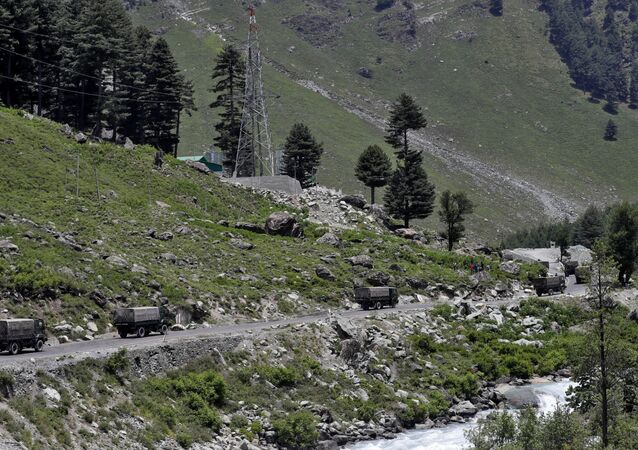 Indian army trucks move along a highway leading to Ladakh, at Gagangeer in Kashmir's Ganderbal district June 17, 2020