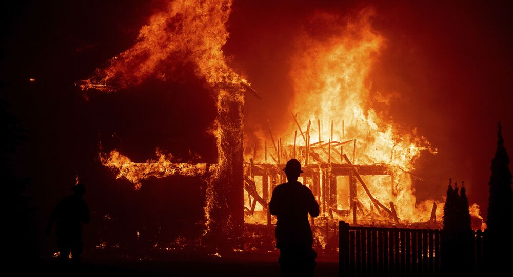 A home burns as the Camp Fire rages through Paradise, California in November 2018. Pacific Gas and Electricity has admitted liability.