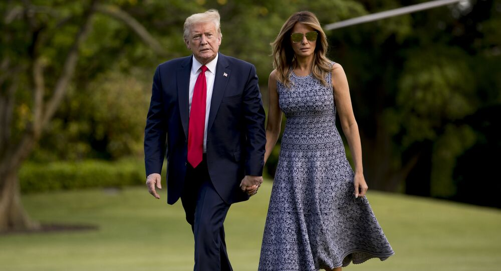 President Donald Trump and first lady Melania Trump return to the White House in Washington, Wednesday, May 27, 2020