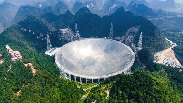 In this Saturday, Sept. 24, 2016 photo released by Xinhua News Agency, an aerial view shows the Five-hundred-meter Aperture Spherical Telescope (FAST) in the remote Pingtang county in southwest China's Guizhou province. China has begun operating the world's largest radio telescope to help search for extraterrestrial life - Sputnik International