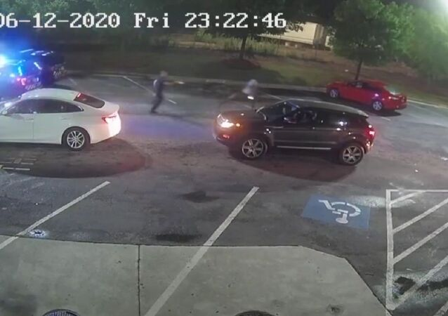Surveillance footage from fast food restaurant captures the moment that two Atlanta Police Department officers chase after local resident Rayshard Brooks before fatally shooting him following a scuffle.