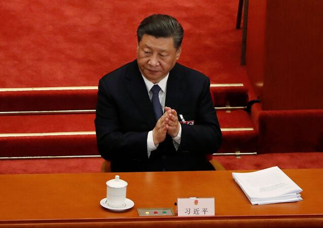 Chinese President Xi Jinping claps his hands at the opening session of the National People's Congress (NPC) at the Great Hall of the People in Beijing, China May 22, 2020.
